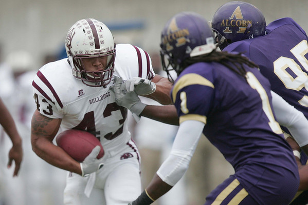 (43) Generion McWhorter of AAMU gains yards aganist Alcorn defense.