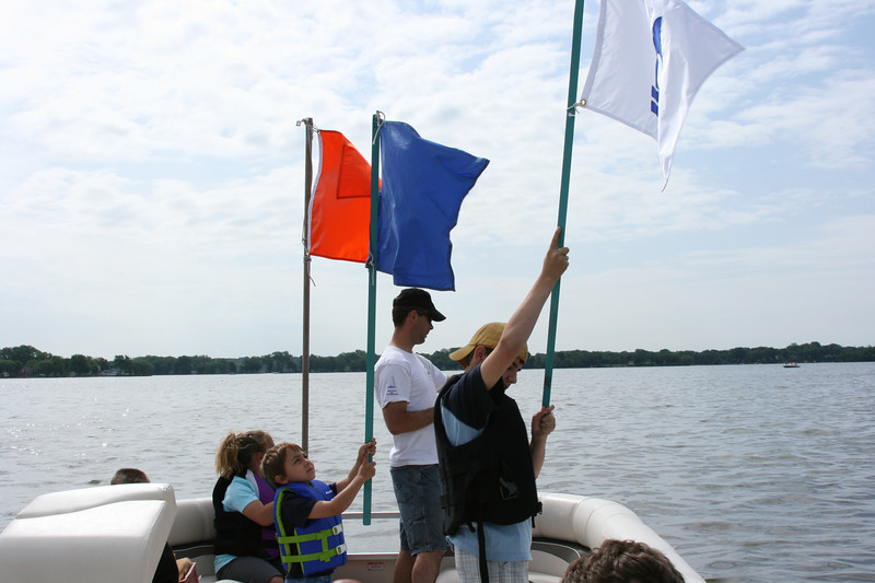 Sailing is something that everybody can get involved in even if they are not out on a sailboat.  We had all the kiddies work the race flags this week on the judge boat.