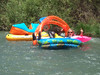 the floating water park . . . yes, that's an inflatable water slide in the extra rowboat