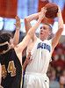 Castlewood's Ruben Rasnick, #1, goes up for shot against Radford's Jerome Alexander, #44. Photo by Ned Jilton II