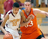 Science Hill's Josh Odem, #10, elbows his way past Morristown East's Austin Gardner, #33. Photo by Ned Jilton II