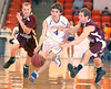 Appalachia's Tyler Hall, #4, splits East Montgomery defenders. Photo by Ned Jilton II