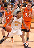 Science Hill's Issac Kinley, #24, drives past Morristown East's Casey Smith, #5, and Austin Gardenr, #33. Photo by Ned Jilton II