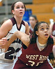 Morristown West's Sidney Goins, #32, boxes out TN High's Kimberly Wood, #23. Photo by Ned Jilton II