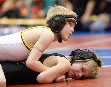 Belvidere Bandits:  Kade Demann maneuvers to pin his opponent in the first round in the 8 and under class.  Demann finished in first place in his class at the tournament.