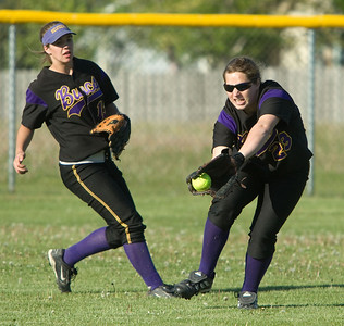 Belvidere High School's Kristy VerHagen (right) grabs a ball hit to center field