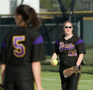 Belvidere High School's Amanda Hartzell (right) at first base after the team's pitcher Kyra Tschumper (left) threw a runner out