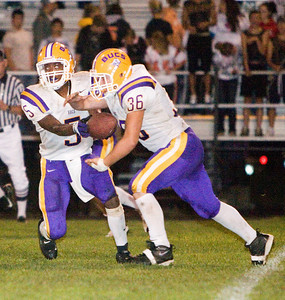 Belvidere High School's Tiras Harris (5) hands off to fullback Matt Safranek during the Bucs' 13-36 loss to the Huskies on Friday, September 5.  The Bucs are 0-2 for the season, while the North Boone High School Blue Thunder and the North Boone High School Vikings are both 1-1.