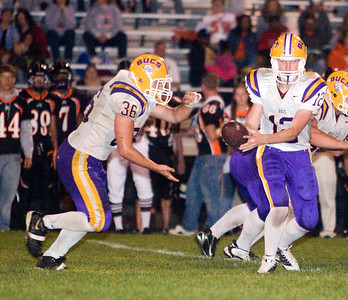 Belvidere High School quarterback James Johnson (12) hands off to fullback Matt Safranek during the Bucs' 13-36 loss to the Huskies on Friday, September 5.  The Bucs are 0-2 for the season, while the North Boone High School Blue Thunder and the North Boone High School Vikings are both 1-1.