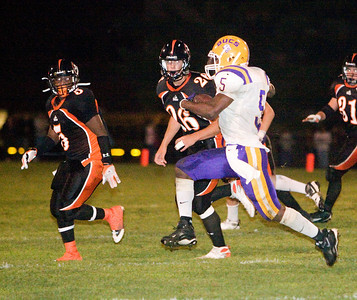 Belvidere High School's Tiras Harris runs downfield during the Bucs' 13-36 loss to the Huskies on Friday, September 5.  The Bucs are 0-2 for the season, while the North Boone High School Blue Thunder and the North Boone High School Vikings are both 1-1.