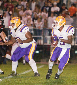 Belvidere High school's Tiras Harris looks for an open receiver during the Bucs' 13-36 loss to the Huskies on Friday, September 5.  The Bucs are 0-2 for the season, while the North Boone High School Blue Thunder and the North Boone High School Vikings are both 1-1.