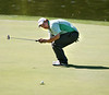 Scott Obenshain of Glenvar watches his ball go in after a putt at the eigth hole. Photo by Erica Yoon