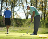 Scott Obenshain of Glenvar putts at the seventh hole as Clint Lowe of Gate City watches. Photo by Erica Yoon