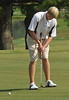 Alex Ratcliff putts on the 18th hole Monday at the Country Club of Bristol. Photo by David Grace