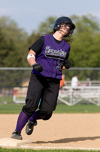 Hampshire:  32 Jessica Kraus rounds third base after hitting a one-run home run
