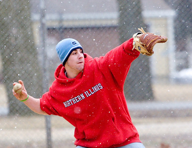 Hiawatha High School junior catcher Kyle Mattis wore a stocking cap and a sweatshirt instead of a ball cap and t-shirt during a rundown drill at baseball practice on Monday afternoon.  By the time practice was over, the temperature had dropped to 33 degrees and snow flurries had begun.