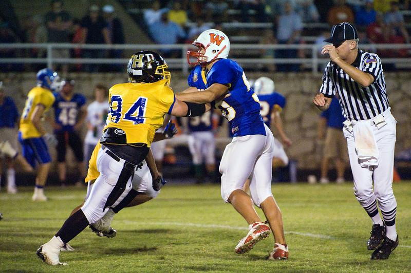 Eric Needham, Wellington, gets by a block by Bryan Thompson (84), Snyder.
