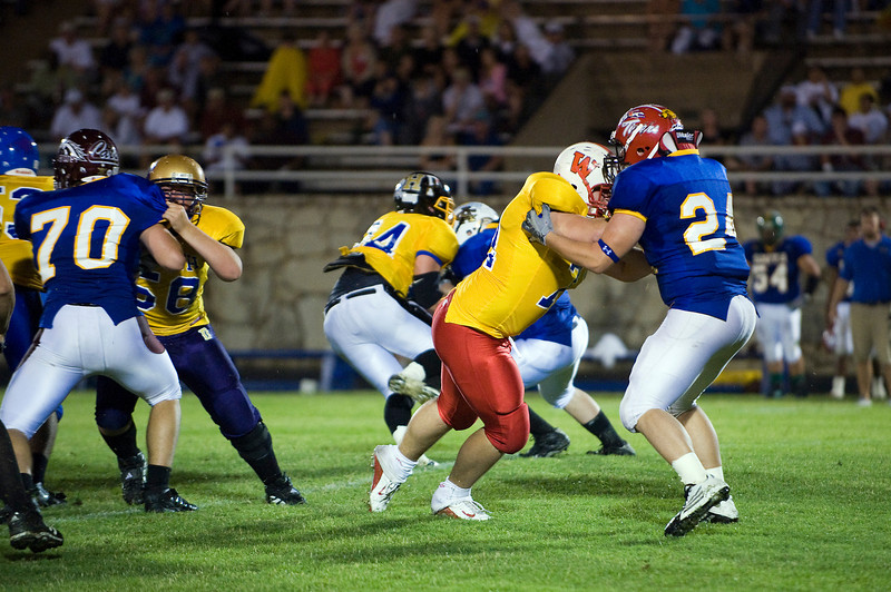 South defensive players Derrick Shelton (70), Clarendon, and Zackery Branch (24), Electra, battle North offensive linemen Andrew Jones (58), Dalhart, and Gus Wilbur (71), Wellington.