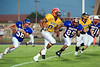 North receiver David Smart (81), Paducah, pursued by Ryan Calhoun (56), Graham, and Alton Gaines (29), Clarendon