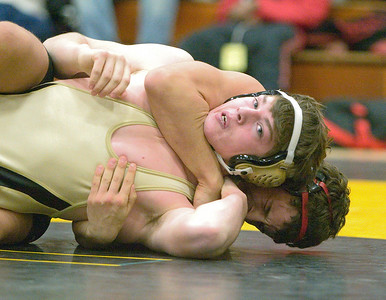 Regional finals:  Huntley's Jordon Bakeley defeats Sycamore's Jake Lancaster 171# by fall (Jordon is correct)