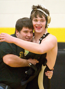 Sycamore's Jake Lancaster defeats Belvidere's Travis Weinsheim in a fall.  After the match he was congratulated by Sycamore wrestling coach Brian Davis.
