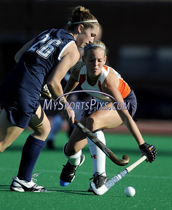 Uconn's Katie Scully (26) of Ossining, New York and Syracuse's Shelby Schraden (23) of Allentown, Pa. during the Big East Field Hockey Championship on Sunday, November 9, 2008 in Storrs, Conn. Syracuse won  1-0 with a goal as time expired to claim the Big East title advancing to the NCAA's. Photo by Mike Orazzi.   http://www.mikeorazziphotography.com/