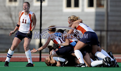 Members of the Syracuse University Field Hockey Team celebrate their 1-0 win over Uconn during the Big East Field Hockey Championship on Sunday, November 9, 2008 in Storrs, Conn. Photo by Mike Orazzi  http://www.mikeorazziphotography.com/