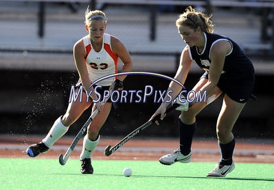 Syracuse University's Shelby Schraden (23) of Allentown, Pa. and Uconn's Jill Kleeblad (23) of Naarden, Holland during the Big East Field Hockey Championship on Sunday, November 9, 2008 in Storrs, Conn. Syracuse won 1-0 with a goal as time expired to claim the Big East title advancing to the NCAA's. Photo by Mike Orazzi.   http://www.mikeorazziphotography.com/