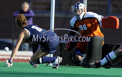 Uconn's Lindsey Leck (3) of Clarksburg, New Jersey has a shot blocked by Syracuse University goalie Heather Hess (96) of Lititz, Pa. during the Big East Field Hockey Championship with Uconn on Sunday, November 9, 2008. Syracuse won 1-0 with a goal as time expired to claim the Big East title advancing to the NCAA's. Photo by Mike Orazzi   http://www.mikeorazziphotography.com/
