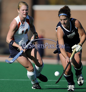 Syracuse University's Lena Voelmle (14) of Hershey, Pa. and Uconn's Kim Krzyk (7) during the Big East Field Hockey Championship on Sunday, November 9, 2008 in Storrs, Conn. Syracuse won 1-0 with a goal as time expired to claim the Big East title advancing to the NCAA's. Photo by Mike Orazzi.   http://www.mikeorazziphotography.com/