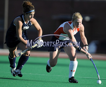 Uconn's Kim Krzyk (7) of Seaville, New Jersey and Syracuse University's Lena Voelmle (14) of Hershey, Pa. during the Big East Field Hockey Championship on Sunday, November 9, 2008 in Storrs, Conn. Syracuse won 1-0 with a goal as time expired to claim the Big East title advancing to the NCAA's. Photo by Mike Orazzi   http://www.mikeorazziphotography.com/
