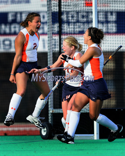 """Syracuse's MaggieBefort (2) of Mechanicsburg, Pa. celebrates her game winning goal as time expires during the Big East Field Hockey Championship with Uconn on Sunday, November 9, 2008 in Storrs, Conn. Celebrating with her are teammates Lena Voelmle (14) of Hershey, Pa. and Nicole Nelson (4) of Telford, Pa. <br /> Photo by Mike Orazzi.<br /> <br />  <a href=""""http://www.mikeorazziphotography.com/"""">http://www.mikeorazziphotography.com/</a>"""