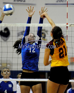 Central Connecticut State University Maite Mendizabal (12) and Iona College's Sarah Wiener (21) at the net during CCSU's 3-2 win on Saturday.