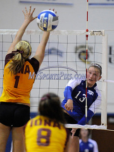 Central Connecticut State University Volleyball player Lauren Synder and Iona College's Alyssa Erickson at the net during CCSU's 3-2 win on Saturday.