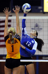 Central Connecticut State University Volleyball player Matie Mendizabal and Iona College's Alyssa Erickson at the net during CCSU's 3-2 win on Saturday.
