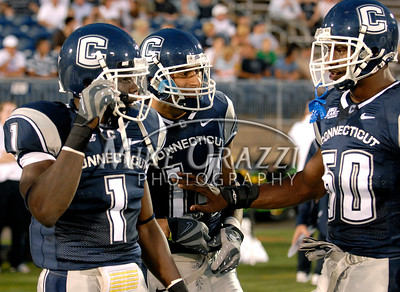8/28/2008 Mike Orazzi | The Bristol Press Uconn's Darius Butler (1), D.J. Hernandez (14) and Cody Brown (50) during a 35-3 win over Hofstra at Rentschler Field on Thursday, August 28, 2008.