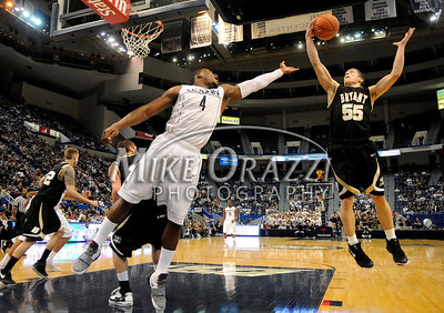 11/29/2008 Mike Orazzi | The Bristol Press Uconn's Jeff Adrien (4) and Bryant's Sam Leclerc (55)during an 88-58 UConn win at the XL  Center in Hartford on Saturday, November 29. 2008.