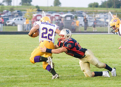 Belvidere North High School's Ryan Karns brings down a Hononegah runner during the Blue Thunder's 40-0 loss on Friday, August 28, 2009.