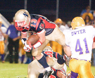 Belvidere North High School's Alex Tripp tries to break through the line during the Blue Thunder's 40-0 loss on Friday, August 28, 2009.