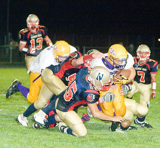 Belvidere North High School's Luis Repport assists in a tackle against a Hononegah runner during the Blue Thunder's 40-0 loss on Friday, August 28, 2009.