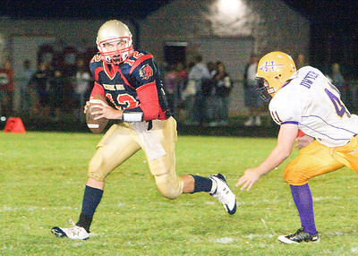 Belvidere North High School's quarterback Keith Larson looks for an open receiver during the Blue Thunder's 40-0 loss on Friday, August 28, 2009.
