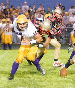 Belvidere North High School's Eric Tamayo causes a Honononegah runner to fumble during the Blue Thunder's 40-0 loss on Friday, August 28, 2009.