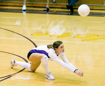 Belvidere High School senior Heather Hyland digs during the Bucs' loss to Rockford East on Tuesday, September 1, 2009.