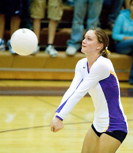 Belvidere High School senior Heather Hyland passes during the Bucs' loss to Rockford East on Tuesday, September 1, 2009.