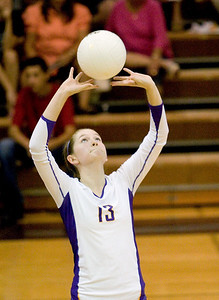 Belvidere High School's Katie O'Malley passes during the Bucs' loss to Rockford East High School on Tuesday, September 1, 2009.