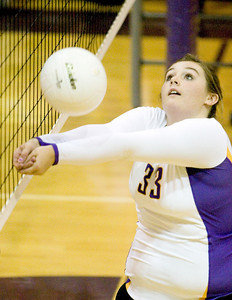 Belvidere High School's Jessica Westbrook passes during the Bucs' loss to Rockford East High School on Tuesday, September 1, 2009.