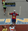 Crossing the finish line with a chip time of 4:19:53