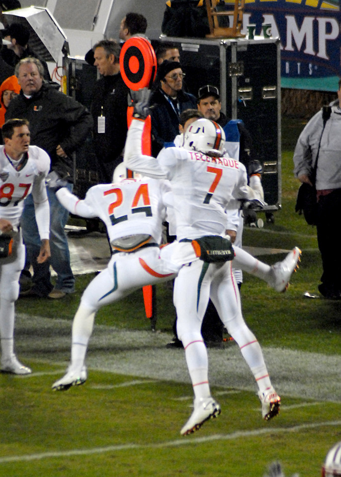 Miami celebrates the fumble recovery in the endzone