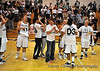 A jubilant DSU team cry and cheer in celebration in the 57-55 win over Montana State University Northern Lights.