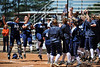 Blue Hawks welcome home #44 Jody Lantz as she crosses the plate after her 2-RBI home run. Score OKC 0, DSU 2.